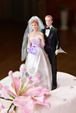 Wedding cake with models of bride and groom Royalty Free Stock Images