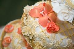 Wedding cake. With orange flowers Stock Photography
