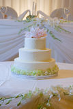 Wedding Cake with Orchids. White Wedding Cake with pink or fuscia orchids royalty free stock photo