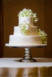 Wedding Cake with Orchids. White Wedding Cake with white and green orchids Stock Images