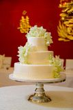 Wedding Cake with Orchids. White Wedding Cake with white and green orchids in a Chinese style wedding Stock Photo