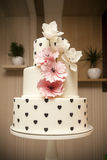 Wedding cake with orchids marzipan Royalty Free Stock Photo
