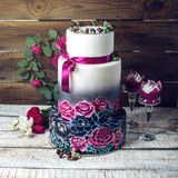 Wedding cake ornamented in rustic style blue and purple roses Royalty Free Stock Image