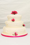 Wedding cake with pink decoration. Stock Photography