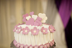 Wedding Cake. Pink flowers decorate the wedding cake close-up Stock Photos