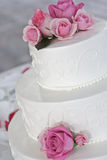 Wedding cake with pink roses Royalty Free Stock Images