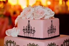Wedding Cake with Pink Roses. Beautiful pink Wedding cake with roses and Black Decoration Elements royalty free stock photo