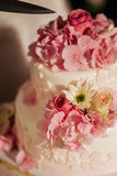 Wedding cake with pink roses Stock Photography
