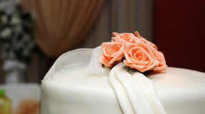 Wedding cake with pink roses Stock Image