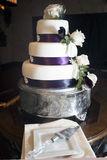 Wedding cake with purple, fondant and white  roses Stock Photography
