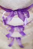 Wedding cake with purple ribbons Royalty Free Stock Images