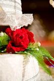 Wedding cake with red floral decoration Stock Images