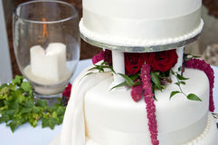 Wedding cake and remembrance candle royalty free stock photography