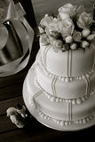 Wedding cake with roses and figurines Stock Photography