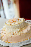 Wedding cake with roses at luxury reception. Stock Photos