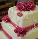 Wedding cake. With roses and rings Stock Images