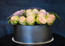 Wedding cake with silver chocolate border and roses