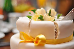Wedding cake. Sliced ​​cake with flowers and marzipan stock photos