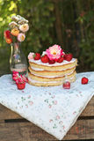 Wedding cake. With strawberries and flowers Stock Photo