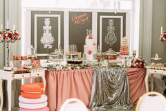 Wedding cake surrounded by sweet assortie Royalty Free Stock Photography