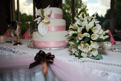 Wedding Cake Table 3. A beautiful wedding cake table and bouquet Royalty Free Stock Photography