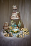 Wedding cake on the table. Wedding cake stands on the decorated table Royalty Free Stock Photo