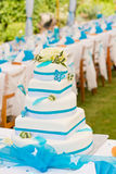 Wedding cake and table setting outdoors Stock Photography