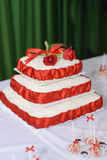Wedding cake. Is on the table and there are some handmade white chocolate candies Royalty Free Stock Images