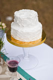 Wedding cake on table and vine Royalty Free Stock Photos