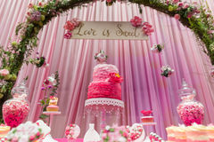 Wedding cake. Tiered wedding cake at indoor wedding party Royalty Free Stock Images