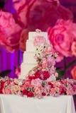 Wedding cake. Tiered wedding cake at indoor wedding party Stock Image