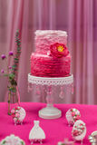 Wedding cake. Tiered wedding cake at indoor wedding party Stock Images