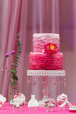 Wedding cake. Tiered wedding cake at indoor wedding party Stock Photos