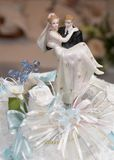 Wedding Cake Top Figurines. Closeup of wedding cake topper figurines at reception Royalty Free Stock Photo