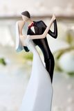 Wedding cake and topper. Bride and groom wedding cake topper stock photo