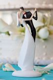 Wedding cake and topper. Bride and groom wedding cake topper stock images