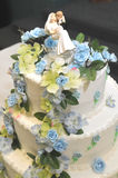 Wedding Cake and topper. Image of a wedding cake and topper stock images