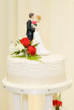 Wedding cake and topper Royalty Free Stock Photo