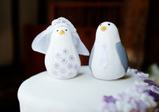 Wedding cake topper. Closeup detail of bride and groom penguins stock photo