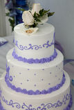Wedding cake and topper with wedding rings Stock Image