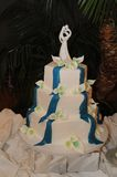 Wedding Cake with topper. White wedding cake trimmed in blue with white figurine topper Stock Images