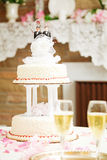 Wedding Cake with Two Groom Topper. Wedding cake with two grooms on top, for gay marriage ceremony Stock Photos