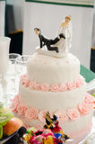 Wedding cake. Weddinfunny  figures of the groom and the bride on wedding cakeg cake Royalty Free Stock Photo