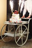 Wedding cake on a wheelchair Royalty Free Stock Image