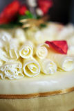 Wedding cake with white chocolate curls. Close up of a wedding cake with bride-made chocolate decorations Royalty Free Stock Image