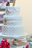 Wedding cake in white. Elegant and romantic big cake Stock Images
