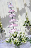 Wedding cake and white flowers Stock Photos