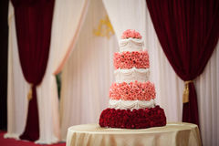 Wedding Cake. White flowers decorated three-tier wedding cake Royalty Free Stock Image