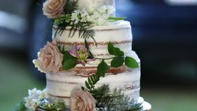 Wedding cake white flowers with greenery in background stock footage