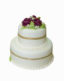 Wedding cake with white icing. Decorated with marzipan roses Royalty Free Stock Photos